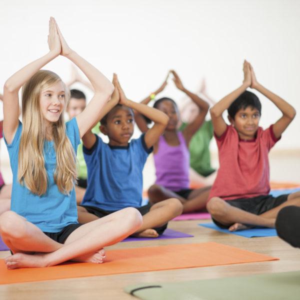 Diverse kids yoga class